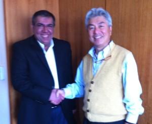 In this photo, OpenIAM President & CEO Suneet Shah shakes hands with Information Development's President & CEO Masaki Funakoshi.